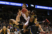 Melo Trimble of the Maryland Terrapins is fouled by Reed Tellinghuisen of the South Dakota State Jackrabbits in the first half during the first round...