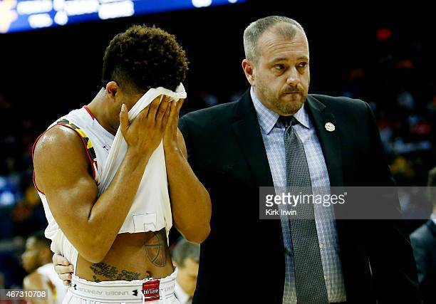 Melo Trimble of the Maryland Terrapins is helped off of the court after being injured for a second time in the second half against the West Virginia...