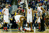 Melo Trimble of the Maryland Terrapins lays on the court after being injured for a second time in the second half against the West Virginia...