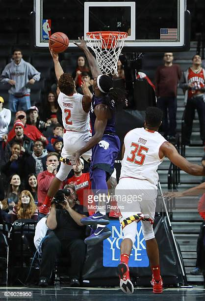 Melo Trimble of the Maryland Terrapins puts in a layup over DJ Johnson of the Kansas State Wildcats in the closing seconds as they win the...