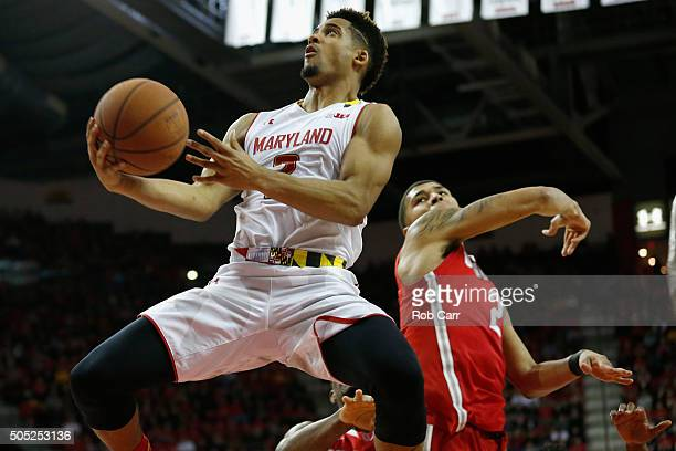 Melo Trimble of the Maryland Terrapins puts up a shot in front of Marc Loving of the Ohio State Buckeyes at Xfinity Center on January 16 2016 in...