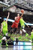 Melo Trimble of the Maryland Terrapins shoots a layup against Alvin Ellis III of the Michigan State Spartans at the Breslin Center on January 23 2016...
