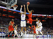 Melo Trimble of the Maryland Terrapins shoots the ball against Landen Lucas of the Kansas Jayhawks in the first half during the 2016 NCAA Men's...