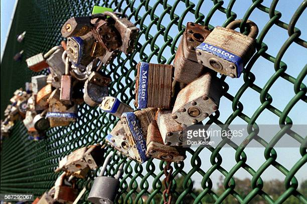 MELocksMystery0716DKPad locks and a few combination locks are a mysterious collection adorning the North side fence on the Fairview Ave bridge that...
