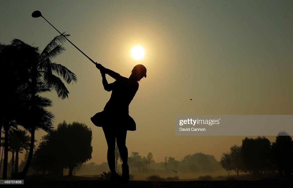 Melodie Bourdy of France plays her tee shot at the par 5 10th hole during the second round of the 2013 Omega Dubai Ladies Masters on the Majilis...