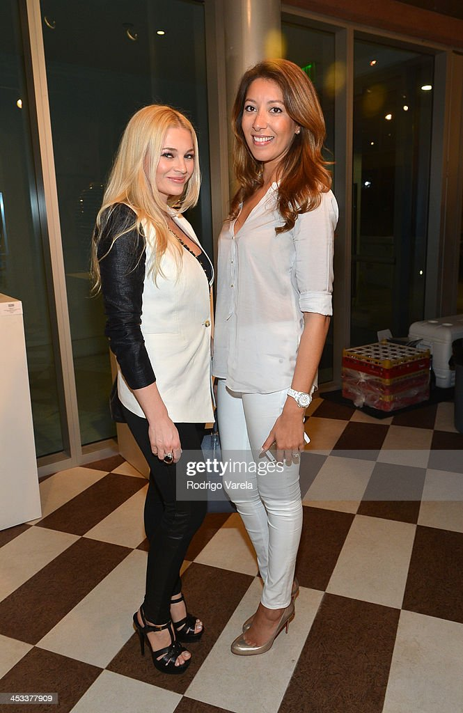 Melodie Marin and Valeria Mola attend the Roman Kriheli Un:veiled Exhibit At Avant Gallery, Featuring The Unveiling Of 'The Most Beautiful Woman In The World' Painting at Epic Hotel on December 3, 2013 in Miami, Florida.