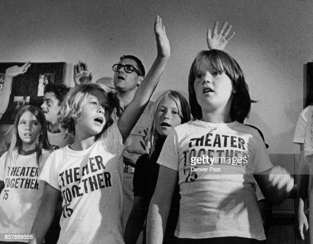 Melodrama Crowns Summer of Study for Amateur Thesplans Elizabeth Bair arm raised left center above and Melinda Gross right sing during performance of...
