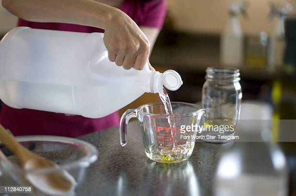 Melody Graves creates a vinegar and olive oil furniture polish as she formulates environmentallyfriendly cleaning products in Mansfield Texas She is...