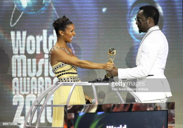Melody Thornton and Will IAM speak on stage during the World Music Awards 2010 at the Sporting Club on May 18 2010 in Monte Carlo Monaco