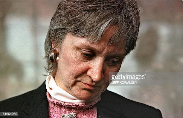 Melody Youk wife of Thomas Youk pauses during a news conference at Oakland County Circuit Court on 25 March 1999 in Pontiac Michigan The jury went...