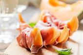 Slices of cantaloupe melon and prosciutto ham, shallow DOFSlices of cantaloupe melon and prosciutto ham, shallow DOF