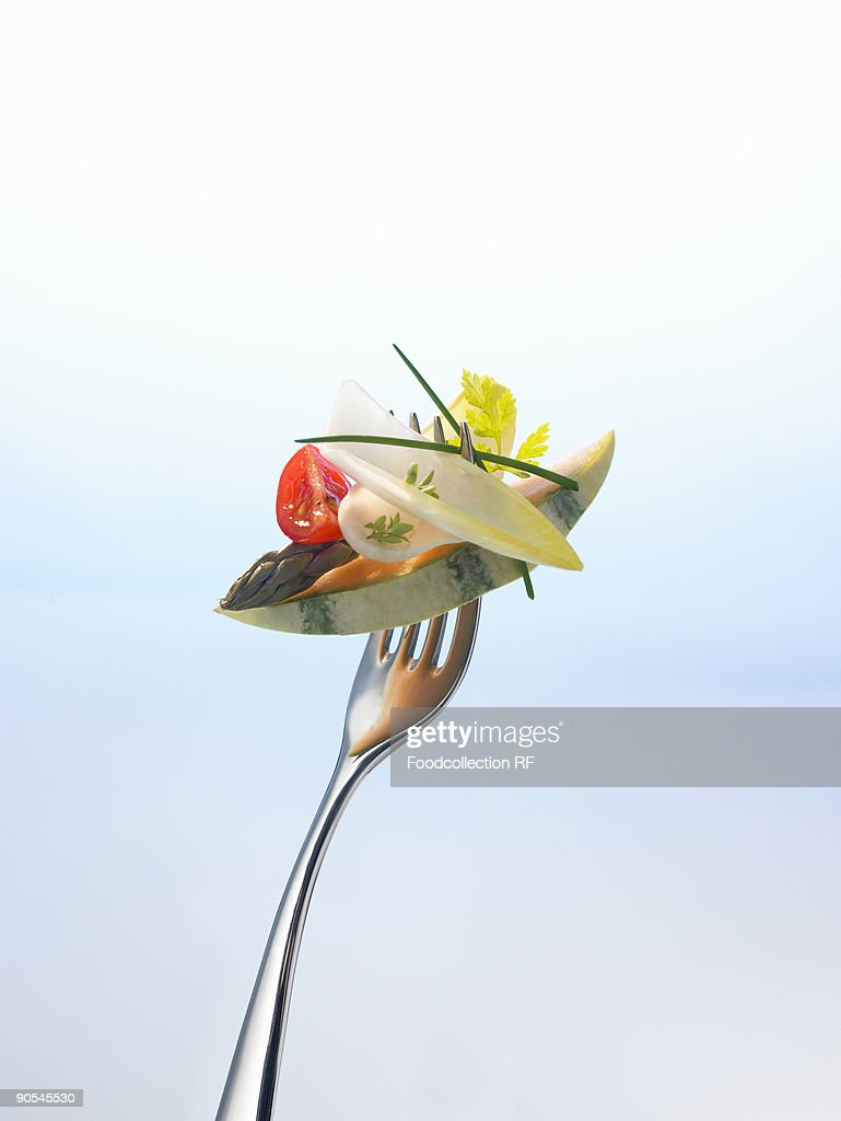 Melon, asparagus and salad on fork, close up : Stock Photo