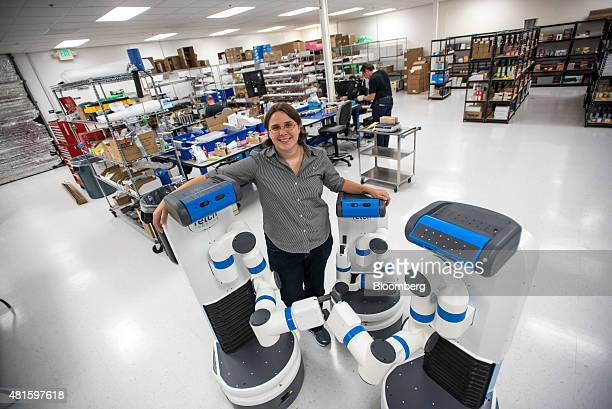 Melonee Wise chief executive officer of Fetch Robotics Inc stands for a photograph with the Fetch Robot at the company's headquarters in San Jose...