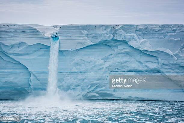 Melt water cascading off Austfonna, Nordaustlandet, Svalbard, Norway, Scandinavia, Europe