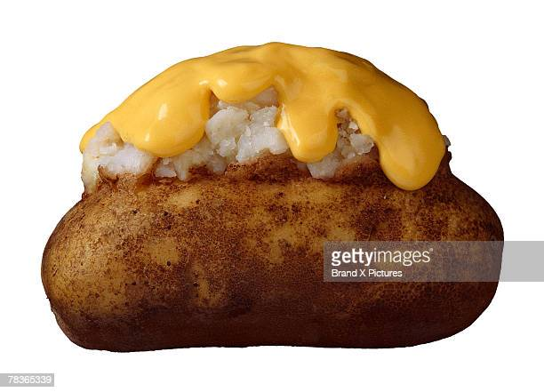 Melted cheese on a baked potato