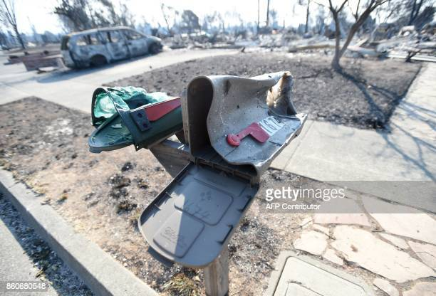 Melted mailboxes are seen near burned properties in Santa Rosa California on October 12 2017 Hundreds of people are still missing in massive...