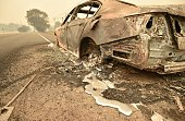 Melted metal flows from a burned out car abandoned on a highway near the Valley fire in Middletown California on September 13 2015 The governor of...