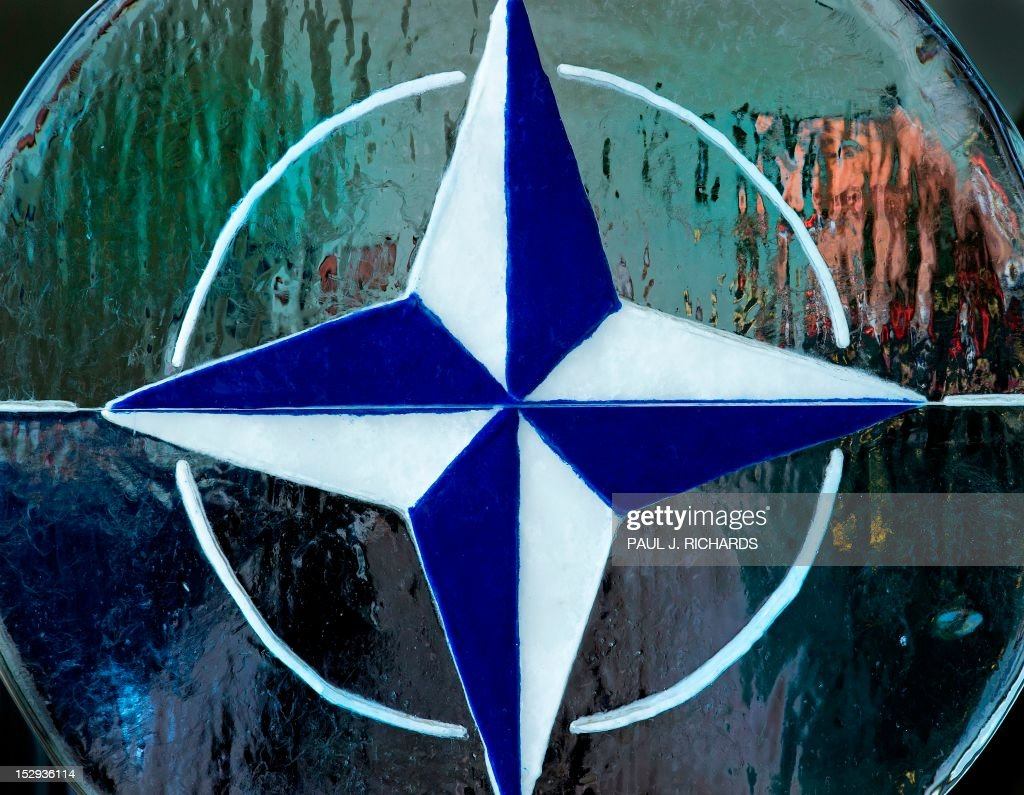 A melting ice sculpture with the NATO/OTAN logo is seen in the reception area for ceremonies at the NATO Supreme Allied Commander Transformation...