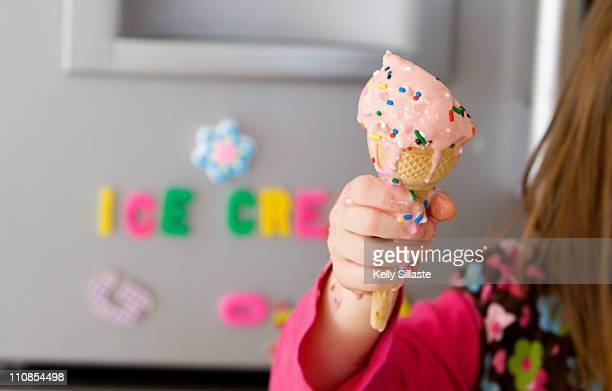 Melting icecream cone with sprinkles