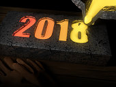 2018 is formed by melted metal cast by a crucible