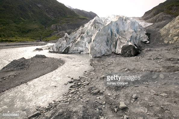 Meltwater flowing from the snout of Exit glacier Kenai Fjords National Park Alaska The glacier is so named as it gave early gold prospectors an easy...