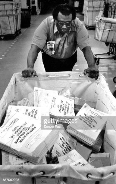 Melvin Campbell an employee at the USPS terminal annex where they have processed the tax forms during the past two days Campbell was pushing one of...