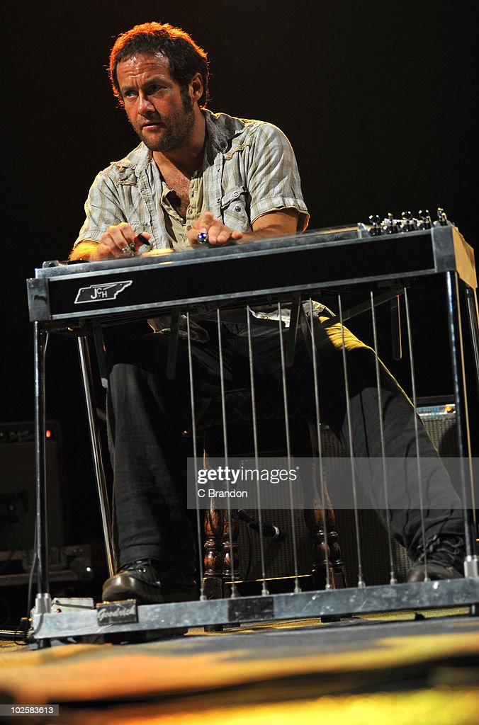 Melvin Duffy of Mojave 3 performs on stage at O2 Arena on June 30, 2010 in London, England. He plays a pedal steel guitar.