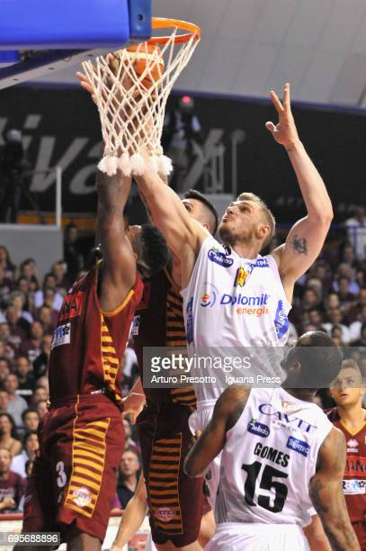 Melvin Ejim and Esteban Batista of Umana competes with Luca Lechthaler and Joao Gomes of Dolomiti during the match game 2 of play off final series of...