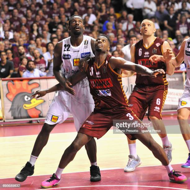 Melvin Ejim and Michael Bramos of Umana competes with Dustin Hogue of Dolomiti during the match game 2 of play off final series of LBA Legabasket of...