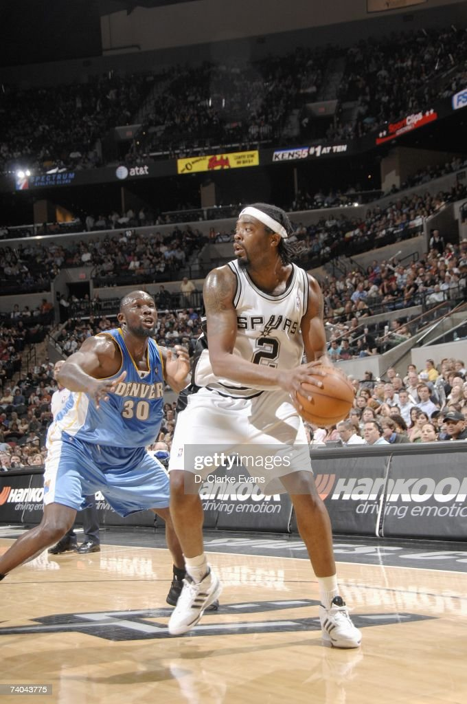 Melvin Ely #2 of the San Antonio Spurs posts up against Reggie Evans #30 of the Denver Nuggets during the game at the AT&T Center on April 18, 2007 in San Antonio, Texas. The Nuggets won 100-77.