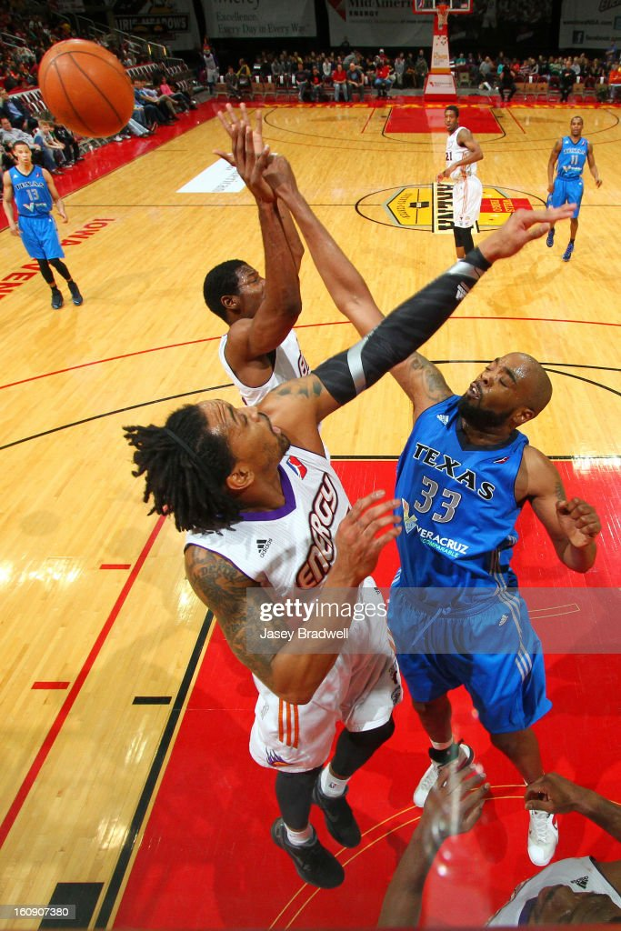 <a gi-track='captionPersonalityLinkClicked' href=/galleries/search?phrase=Melvin+Ely&family=editorial&specificpeople=202960 ng-click='$event.stopPropagation()'>Melvin Ely</a> #33 of the Texas Legends rejects a shot attempted by Paul Harris #14 of the Iowa Energy in the NBA D-League game on February 7, 2013 at the Wells Fargo Arena in Des Moines, Iowa.