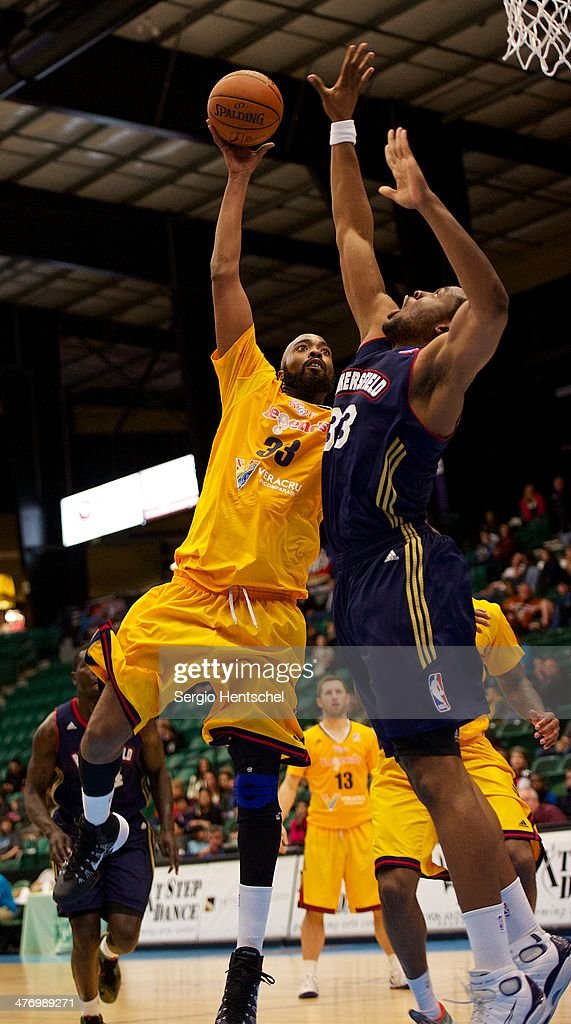 Melvin Ely of the Texas Legends shoots over Ike Diogu of the Bakersfield Jam on March 5 2014 at Dr Pepper Arena in Frisco Texas NOTE TO USER User...
