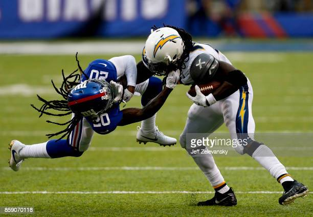 Melvin Gordon of the Los Angeles Chargers breaks free of Janoris Jenkins of the New York Giants during their game at MetLife Stadium on October 8...