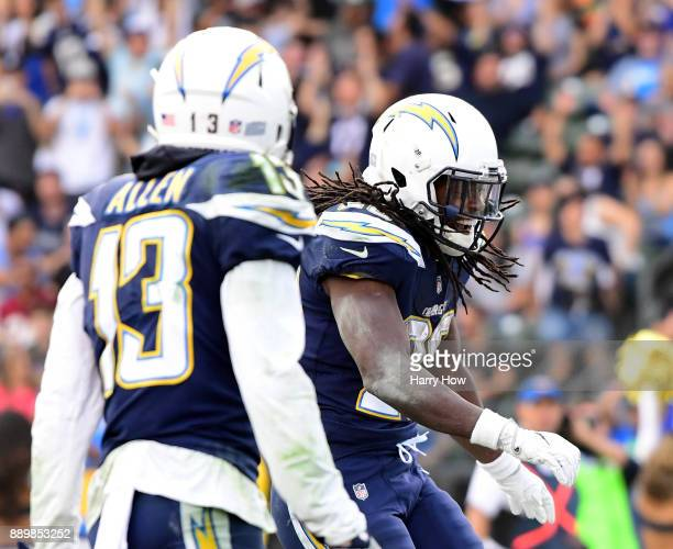 Melvin Gordon of the Los Angeles Chargers celebrates his touchdown to take a 306 lead over the Washington Redskins during the third quarter in a 3013...