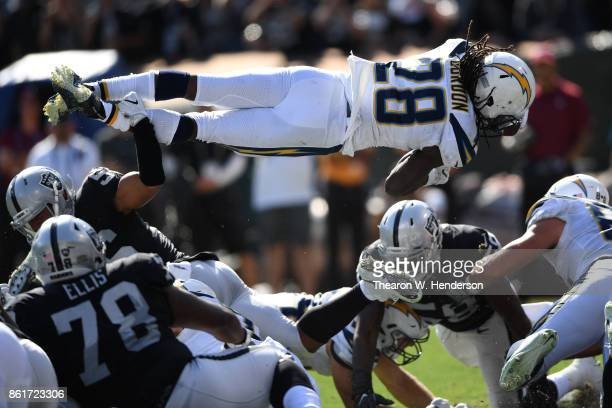 Melvin Gordon of the Los Angeles Chargers dives for a 1yard touchdown against the Oakland Raiders during their NFL game at OaklandAlameda County...