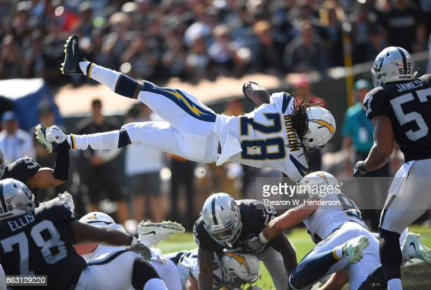 Melvin Gordon of the Los Angeles Chargers dives for a 1yard touchdown against the Oakland Raiders during an NFL football game at OaklandAlameda...