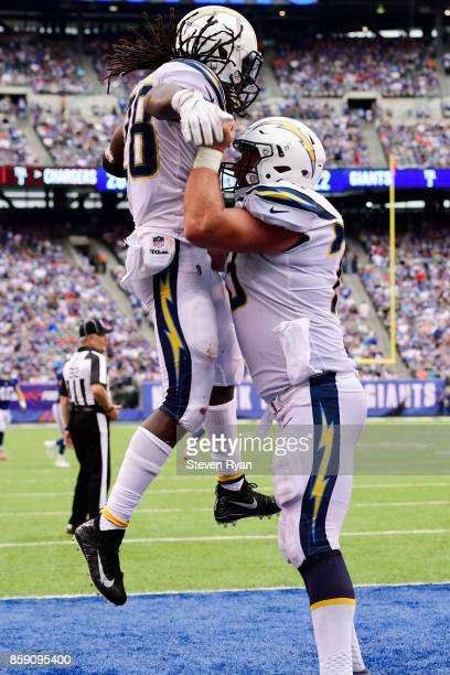 Melvin Gordon of the Los Angeles Chargers is congratulated by his teammate Spencer Pulley after scoring a fourth quarter touchdown against the New...