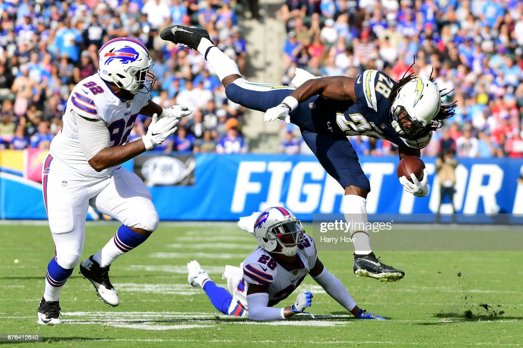 Melvin Gordon #28 of the Los Angeles Chargers leaps over E.J. Gaines #28 of the Buffalo Bills during the first half of the game at StubHub Center on November 19, 2017 in Carson, California.