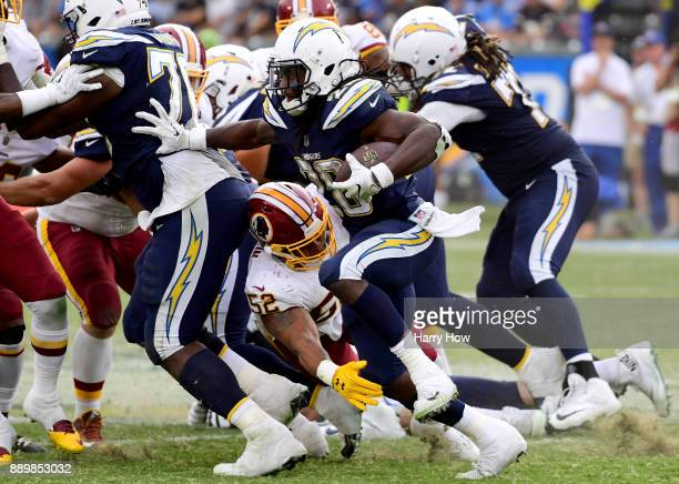 Melvin Gordon of the Los Angeles Chargers rushes the ball during the fourth quarter in a 3013 win over the Washington Redskins at StubHub Center on...
