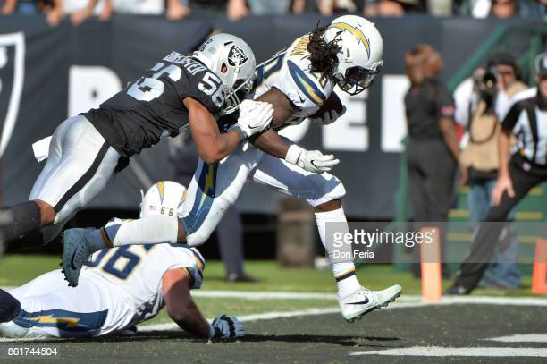 Melvin Gordon of the Los Angeles Chargers scores a sixyard touchdown against the Oakland Raiders during their NFL game at OaklandAlameda County...