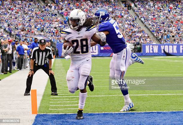 Melvin Gordon of the Los Angeles Chargers scores the eventual game winning touchdown past Keenan Robinson of the New York Giants during the fourth...