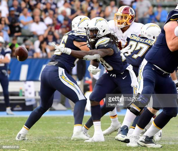 Melvin Gordon of the Los Angeles Chargers tosses the ball back on a flea flicker resulting in a Keenan Allen touchdown during the third quarter in a...