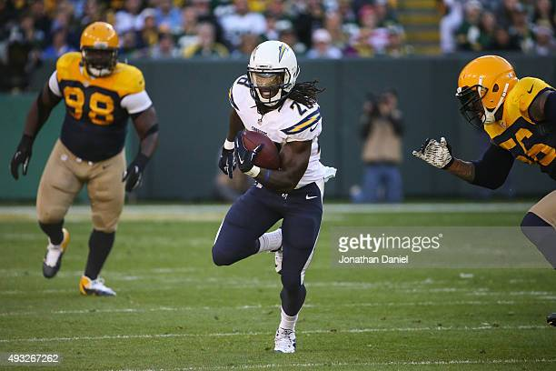 Melvin Gordon of the San Diego Chargers carries the football against the Green Bay Packers in the first quarter at Lambeau Field on October 18 2015...