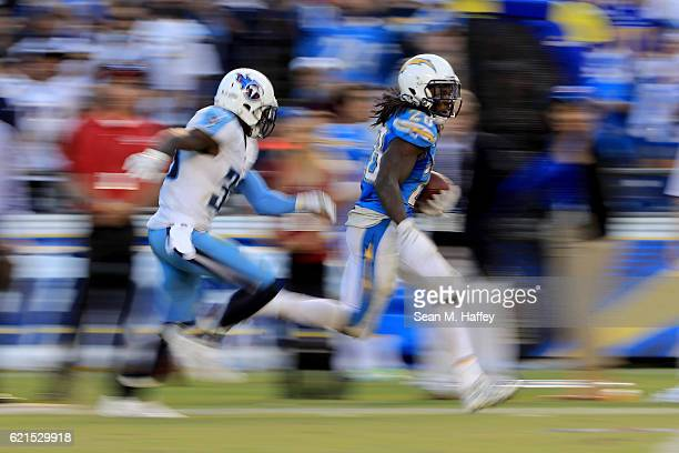 Melvin Gordon of the San Diego Chargers eludes Jason McCourty of the Tennessee Titans on a 35 yard pass play during the second half of a game at...