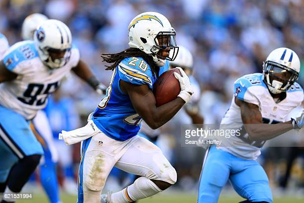 Melvin Gordon of the San Diego Chargers runs with the ball as Jurrell Casey of the Tennessee Titans chases during the second half of a game at...