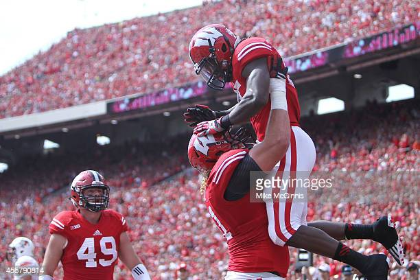 Melvin Gordon of the Wisconsin Badgers celebrates after scoring a touchdown during the first quarter against the Bowling Green Falcons at Camp...
