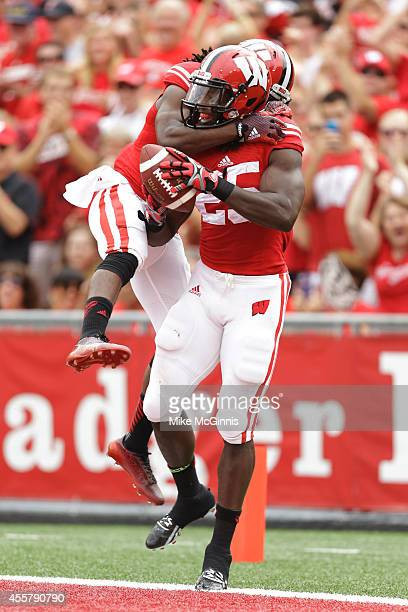 Melvin Gordon of the Wisconsin Badgers celebrates with Kenzel Doe after scoring a touchdown during the second quarter against the Bowling Green...