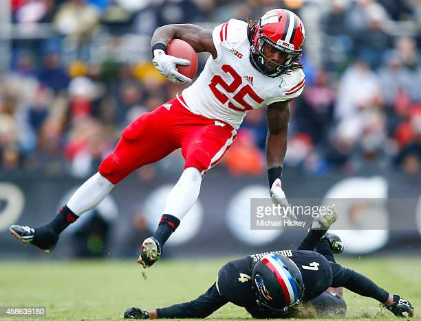 Melvin Gordon of the Wisconsin Badgers runs the ball as Taylor Richards of the Purdue Boilermakers attempts the tackle at RossAde Stadium on November...
