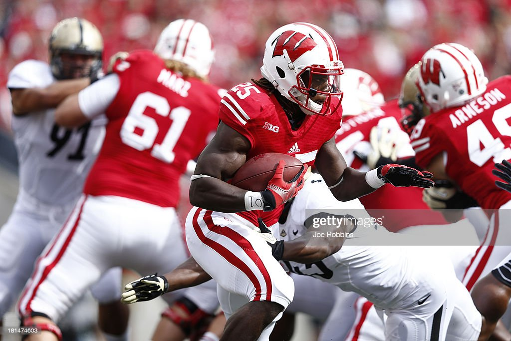 Melvin Gordon #25 of the Wisconsin Badgers runs with the ball against the Purdue Boilermakers during the game at Camp Randall Stadium on September 21, 2013 in Madison, Wisconsin.