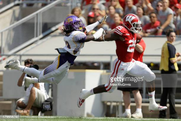 Melvin Gordon of the Wisconsin Badgers shakes off Matt Hamby Tennessee Tech Golden Eagles and runs for a touchdown during the game against the at...